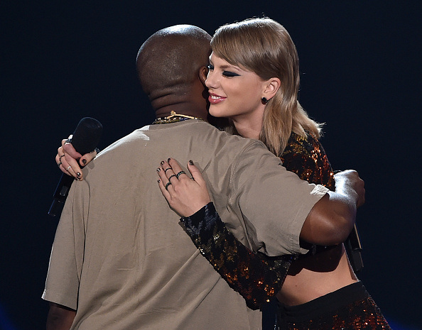 LOS ANGELES, CA - AUGUST 30:  Recording artist Kanye West (L) accepts the Video Vanguard Award from recording artist Taylor Swift onstage during the 2015 MTV Video Music Awards at Microsoft Theater on August 30, 2015 in Los Angeles, California.  (Photo by Kevin Winter/MTV1415/Getty Images For MTV)